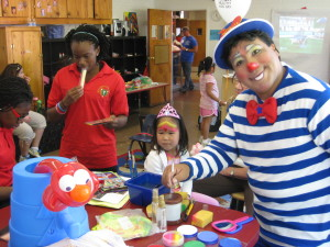 Pelukyta face painting at a charity event for the YMCA